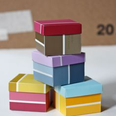 Paint swatch boxes- tutorial availabe at: http://howaboutorange.blogspot.com/2011/07/how-to-make-boxes-from-paint-swatches.html?m=1