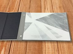 (Image 1 of 3): Interscrew binder, which can be opened by the customer any time to add/remove sheets. The customer wanted the cover to fold several times to create a look and feel similar to an iPad case. Bookbound by www.document-centre.co.uk (London).