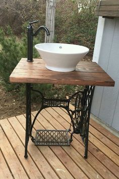 This unique bathroom vanity is sure to be an excellent conversation piece! A must have for up-cycling, vintage, and rustic lovers. Up-cycled vintage Singer sewing machine base made into rustic bathroom vanity. Includes the vanity base, vessel sink, fauce Sewing Machine Drawers, Sewing Machine Tables, Antique Sewing Machines, Sewing Table, Rustic Bathroom Vanities, Vintage Bathrooms, Rustic Bathrooms, Bathroom Sinks, Vanity Faucets