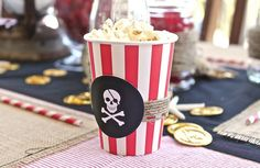 Pirate party - red and white striped cups with added paper craft embellishment. fill with popcorn.