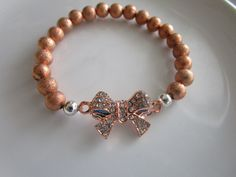 Rose pink gold clear bejeweled bow bracelet - bow jewelry - rose gold bracelet - pink gold bracelet - bow charm - rose gold jewelry - bows by LeeliaDesigns on Etsy https://www.etsy.com/listing/271309908/rose-pink-gold-clear-bejeweled-bow