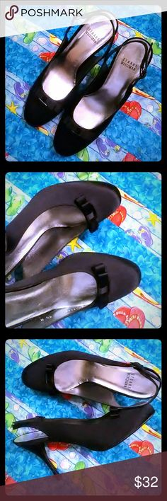 A Black Heel Bow. It's NEW. Black heels with bow. Not worn. Just tried on at the store. Stuart Weitzman Shoes Heels
