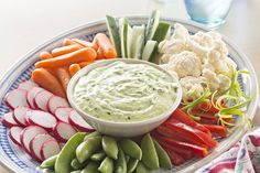 why not make this with some green goddess dressing and sour cream.love the sliced radishes.Cut up fresh veggies, like baby carrots and red peppers, for our Green Goddess Dip with Spring Vegetables! Guests will love our festive green goddess dip. Party Dip Recipes, Appetizer Recipes, Appetizers, Kraft Recipes, Vinaigrette, Green Goddess Dip, Crudite, Cooking Instructions, Fresh Vegetables