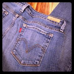 """Levis low Bootcut 545 Jeans Levis 545 Low Bootcut 545 jeans. 99% cotton and 1% spandex. 8 SHORT. Worn but in great broke in shape. Color is medium wash. Length is 38"""" and inseam is 28.5"""". Levi's Jeans Boot Cut"""