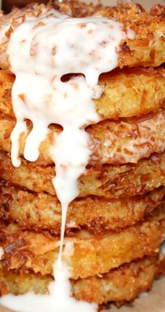 Deep Fried Pina Colada Rings ~ Rum soaked pineapple rings are coated then flash-fried to a crispy, golden crunch and then drizzled with run sauce. Im going to try it without rum- wonder if itll still be a tasty deep fried treat Deep Fried Desserts, Just Desserts, Delicious Desserts, Yummy Food, Pineapple Recipes, Fruit Recipes, Dessert Recipes, Cooking Recipes, Pineapple Rum