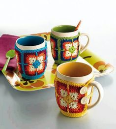 Button-on Mug Cozy | crochet granny square mug cozies, pattern in Granny Squares: 25 Creative Ways to Crochet the Classic Pattern