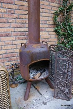 an old propane tank recycled into a fire pit for our garden