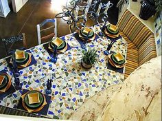 Theis unique custom kitchen table was created by using a variety of materials including hand-made Mexican ceramic tiles on a wrought iron base for this Mediterranean style home.