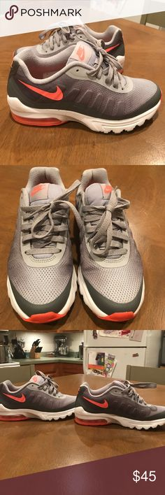 Grey and bright coral Nike's Worn once. Too tight on me. Nike Shoes Sneakers