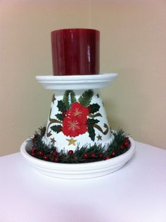 Christmas candle and holder made with clay pot and saucers by Lawana Puderer