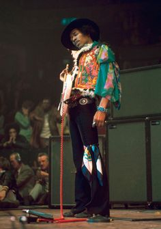 The look; with the scarf around his leg, the far out waistcoat and blouse - Jimi my man!