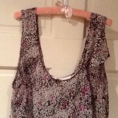 BCBGeneration tank top polyester size small BCBGeneration tank top with side ruffle accent polyester size small hardly worn. Grey with black and pinkish purple pattern. can be worn with a top underneath or alone. BCBGeneration Tops Tank Tops