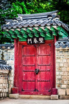 Striking red doors guard the entrance to a beautiful Korean garden. While in Seoul, Korea to photograph a wedding, I had the privelige of sight