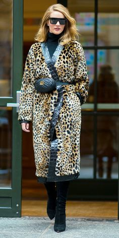 Rosie Huntington-Whiteley's slay has no chill. This time, she stunned in a turtleneck and Attico leopard coat trimmed with leather ($1,485; net-a-porter.com). A Gucci belt bag ($1,100; farfetch.com), suede boots, and square sunglasses completed her winning look.