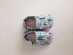 featuring a denim style blue and natural cream broken arrow damask on nice thick cotton.  These shoes are fantastic for boys and girls.  Great for babies learning to walk because they can still grip the ground and balance.
