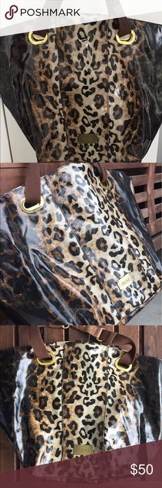 Purse PRÜNE animal print (Leopard bag ) importad PRÜNE leopard bag in eco leather animal print. In the back of the bag has two pockets with zippers and the other side pocket for cellphone . Is an imported leather semil bag.product width: 14 cm, length 40 cm,color: animal print PRÜNE Bags Shoulder Bags