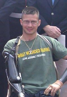 """Todd Nicely, an American hero, who by the looks of his shirt, has a great sense of humor too. He is a quadruple amputee. Love the shirt: """" Combat Wounded Marine, Some assembly required. Thank you for your service and sacrifice! My Marine, Marine Corps, We Are The World, In This World, Usmc, Marines, My Champion, Wounded Warrior, Support Our Troops"""