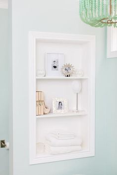 Wall paint color is Sherwin Williams Dewy. Beautiful bathroom design from Natalie Clayman.