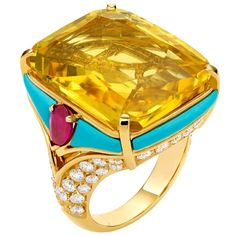 Bulgari~Sapphire, Rubies, Turquoise 7 pave diamonds set in 18kt yellow gold. Contemporary in design.