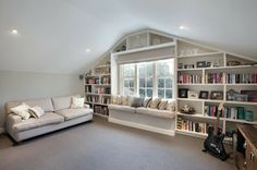 built in shelves around window and window seat