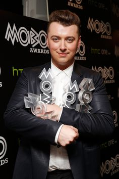 Sam Smith held on tight to his trophies after his winning night at the MOBO Awards in London on Wednesday.
