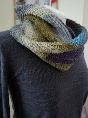 A simple cowl knit in garter stitch. Short rows are used to build a series of triangles with one skein of Noro silk garden sock. The ends are seemed together to produce an elegant cowl.