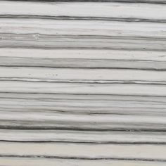 Zebrino Bianco features dramatic linear bands of medium to dark grey on an off while/cream background.  Available in slabs. Contact our sales department for product pricing and availability.  Reference Item No. MAR868