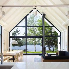 Window on the Lake Cottage in Saint-Élie-de-Caxton by Design by the minimalist Window on a Lake cottage features wood construction both outside and in with a gable roof that makes for optimal views of the water. Lakeside Cottage, Modern Cottage, Lake Cottage, Modern Lake House, Contemporary Cottage, Wood Cottage, Lakeside Living, Cottage Windows, A Frame House