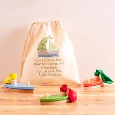 Three Wooden Balloon Boat Toys And Personalised Bag - There's plenty you can do with the kids to keep them entertained come rain or shine this summer.
