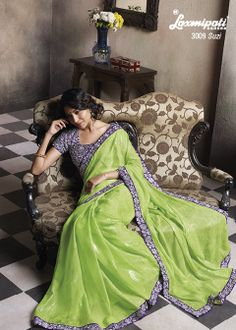 Foil Printed Chifon saree with its perfect Green colour , and impressive Zari work on Violet lace and Blouse has a special effect.