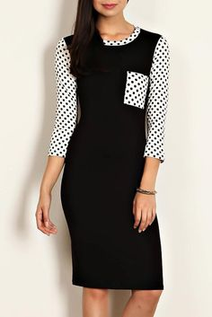 Love this classy knee length black and white dress.