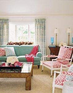Eyes on the Coffee Table. notice that under the glass looks like covered in pictures. Love that idea. I also like the look of the table--looks like twine wrap but maybe it's wooden. fab
