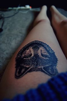 a wolf in a leg - tattoo
