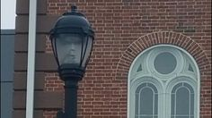 The Internet Is Freaking Out Over This Ghost Face Trapped In A Lamppost