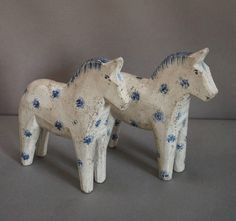 Pair of White Dala Horses | From a unique collection of antique and modern sculptures and carvings at https://www.1stdibs.com/furniture/folk-art/sculptures-carvings/