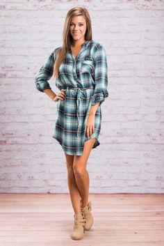 We saw how much you loved this dress so we decided to bring it back! Plaid tops have been a huge fall trend but sometimes you just want to be a little more girly. Which is why this plaid dress is so perfect! It's got the button-down feel and cozy look of all your fave plaid tops, but with an extra kick of cute! The tied, drawstring waist keeps this dress flattering and the tabs on the sleeves help you keep the sleeves rolled up for a super chic look.