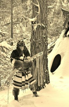 Mountain Man & fur trapper TwoBears keeping warm in a Capote