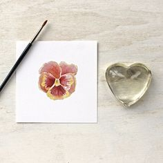 Print of a rusty red pansy by watercolor artist Kathleen Maunder, trowelandpaintbrush