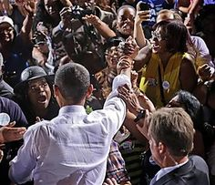 #55 - 10/1/12 - President Barack Obama, center, greets supporters after speaking at a campaign event in Desert Pines High School, Sunday, Sept. 30, 2012 in Las Vegas. (AP Photo/Pablo Martinez Monsivais)