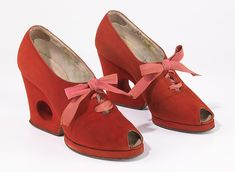 Shoes by Delman, 1937-39, made of leather and silk. Shoes of the 30's were usually platforms or wedges. These are interesting, because it is like a hybrid wedge/heel.