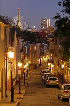 Boston skyline at twilight showing landmarks such as John Hancock building and Leonard P. Zakim Bunker Hill Memorial Bridge.