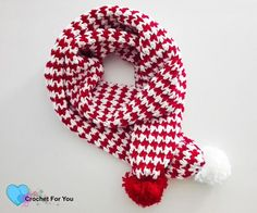 Peppermint Houndstooth Scarf. This scarf looks fun and cheerful all together Houndstooth stitch and peppermint color. And especially with the pom pom.