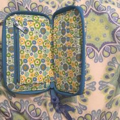 Vera Bradley wallet Has a card slot, inside has a coin zipper, outside on back has a phone slot Vera Bradley Bags Wallets