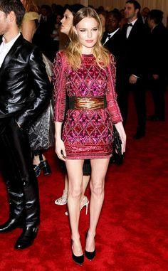 Kate Bosworth in a long-sleeved embellished Balmain dress.