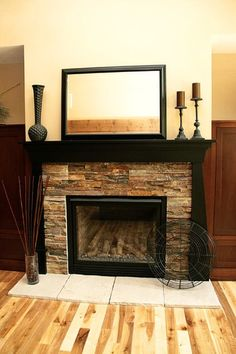 Love the black fireplace mantel with wood surround. | For the Home