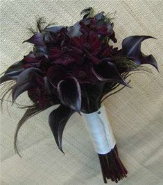Wedding Bouquets - Black Roses and Calla Lilies with black feathers adding extra glam.