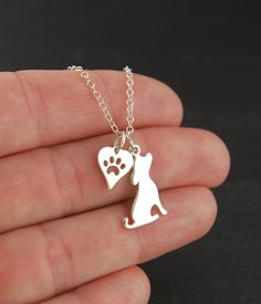 Hey, I found this really awesome Etsy listing at https://www.etsy.com/listing/171078681/dog-or-cat-charm-with-heart-paw-print