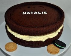 big oreo cookie layer cake -pinned this because it has my name piped in frosting on it