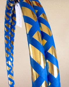You can choose any color you'd like to replace the electric blue gaffer tape for your own custom Metallic Hula Hoop!  The Blue & Gold Metallic Hula Hoop pictured above is decorated with Gold Mirror Deco tape, and Electric Blue Gaffer (grip) tape in a crisscross pattern.