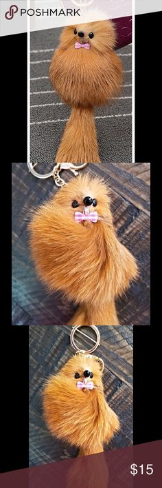 🆕Adorable Furry Friend Keychain Genuine Fox Fur Reddish Brown Color. Super Cute! Genuine fox fur. Gold hardware. Has lobster claw clasp as well as key ring.  Perfect for handbag, keys, or backpack. Approximately 7.5 inches long not including chain. Chain is about 4 inches long.  Width of body is approximately 3 inches across. There may be slight variations from item to item due to the nature of natural fur. Feel free to ask questions. Price is firm unless bundled. Save 20% off when bundling…